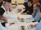Busby works on a competition charrette with collaborators.