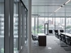 A boardroom with downtown views overlooks the central atrium. Maris Mezulis