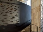 Smooth-cut Algonquin limestone tiles clad the main lobby and feature stair. James Brittain