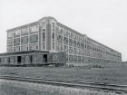 Designed by Albert Kahn in 1914, the Dominion Tire Plant in Kitchener used reinforced concrete to create open floor plans with ample natural light. The factory still operates as a rubber-manufacturing facility.