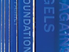 Brilliant cobalt blue vertical glass fins feature the names of major donors, and form an integral and recognizable element of the prominent Bay Street facade of the Peter Gilgan Centre for Research and Learning.