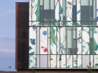 The floral patterns enlivening the glass curtain wall at the University of Waterloo School of Pharmacy are a poetic reference to the plant-based origins of many pharmaceuticals, and inject vitality into a gritty part of downtown Kitchener.