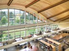 A view of the library reading room, where the curved roof frames dramatic views of the campus and its alpine surroundings.