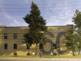 A supergraphic created by artist Pascal Paquette gives the building a bold identity in the neighbourhood.