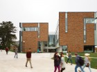 A courtyard entrance welcomes students to the new facility.