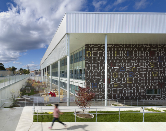 winner micah lexier's 2014 text-and-number collaboration with kohn shnier architects for the faade of the fraser mustard academy for early learning in thorncliffe park, toronto.