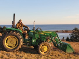 brian mackay-lyons atop his tractor