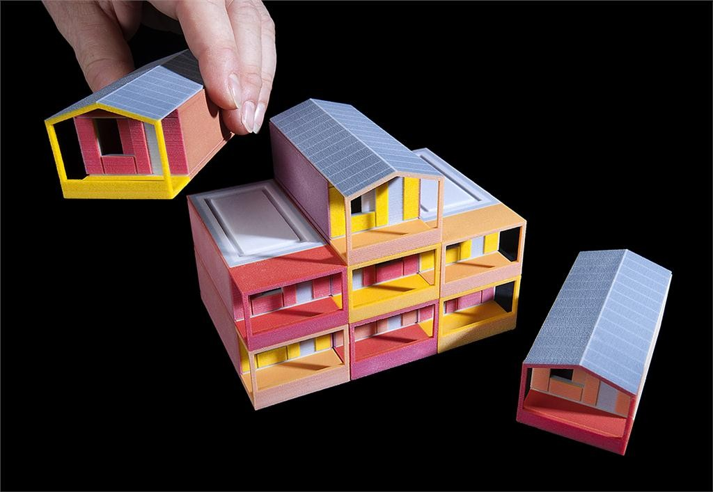 model of y:cube temporary housing project by rogers stirk harbour + partners