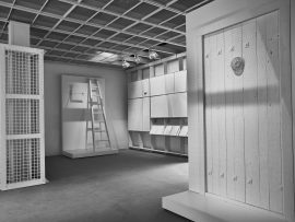 Interior perspective of The Evidence Room with models of Auschwitz gas column and gastight hatch, plaster casts and model of gastight door. Photo by Fred Hunsberger.