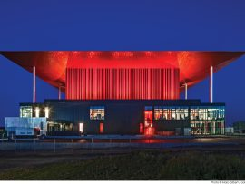 A tapered red roof and aluminum-clad fly tower give the amphitheatre an iconic presence in Trois-Rivières.