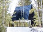 Lake Cottage's starting point is a standard A-frame, rendered in black steel and charred cedar. Photo by Naho Kubota