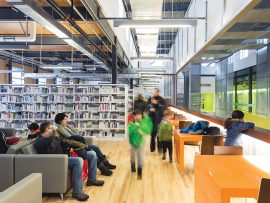 The exposed structure allows natural light to fill the library.