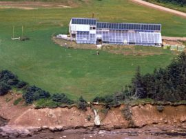 An image of the PEI Ark just after completion, showing its south-facing greenhouse and solar panel arrays. Courtesy of Solsearch Architects / BGHJ Architect