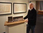 Architect David Bergmark places a model of the PEI Ark on its pedestal. Photo: John Leroux
