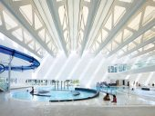 A calm white interior unites the array of pools inside the Guildford Aquatic Centre, one of several new recreation facilities in British Columbia's fastest growing city. Photo: Ema Peter