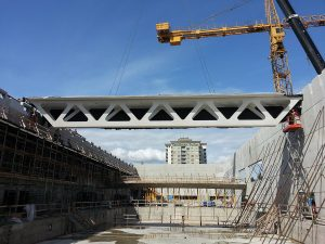 The CNC-cut laminated strand lumber trusses were prefabricated off-site, complete with mechanical and electrical equipment, and lifted into place by crane. Photo: Isaac Epp