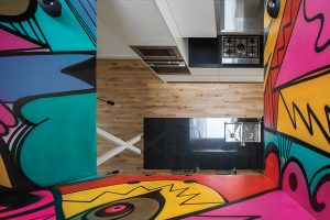 Graffiti-like murals by a local artist adorn the light court in the upper unit.