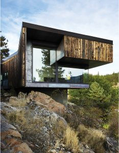 The Friesen-Wong House cantilevers outwards from a rocky ridge overlooking a river in B.C.'s Okanagan Valley. Photo: Martin Tessler