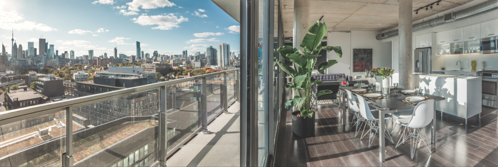 An open-plan suite enjoys sweeping views of downtown Toronto.