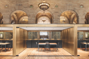Private meeting rooms are set like jewel boxes behind the teller counters.
