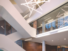 The main entry from University Avenue includes a sculptural stair and playful lighting.