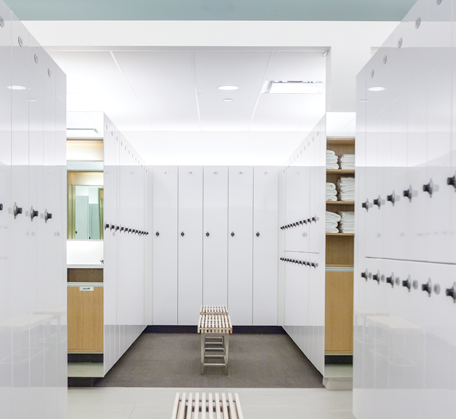 The locker rooms are finished in a natural palette of maple and white surfaces. Photo by Scott Norsworthy