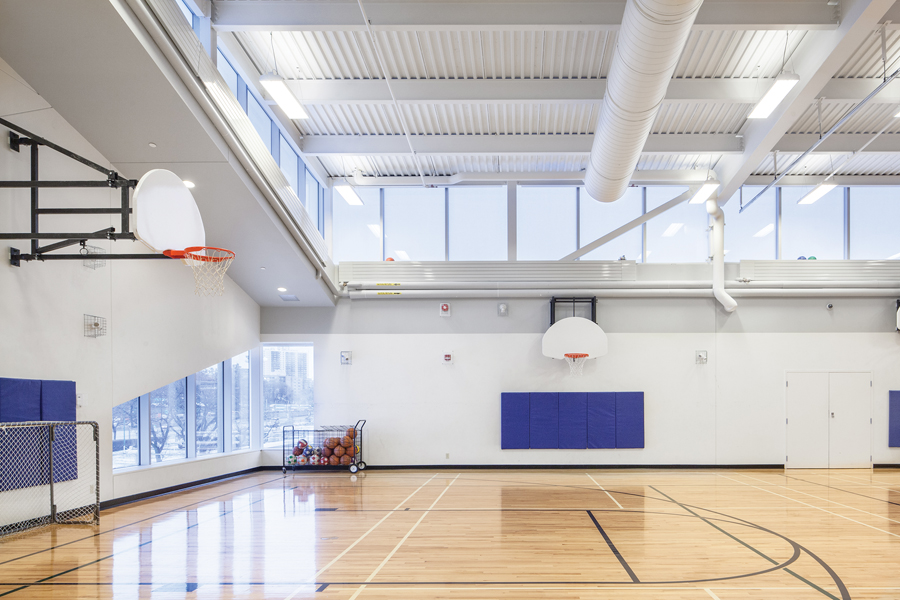 Clerestories and a slice of windows bring natural light into the upper floor gymnasium. Photo by Scott Norsworthy