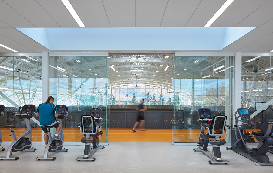 Adjacent the fitness area, a running track encircles the gymnasium. Photo by Shai Gil
