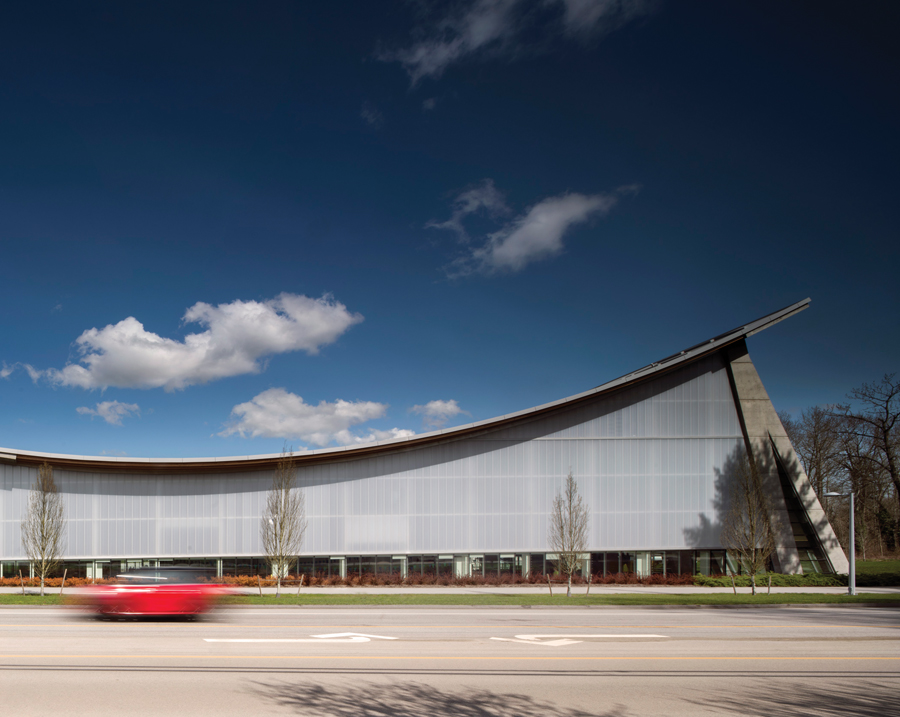 The sweeping profile of the new aquatic centre creates a strong presence along 24 Avenue in Surrey, B.C. Photo by Nic Lehoux