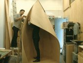 Staff at Patkau Architects assemble a full-scale mockup of a skating shelter at the back of the firm's office in Vancouver