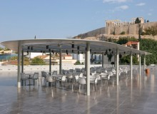 STUA's Gas chairs and Zero tables grace the terrace of the Acropolis Museum, facing the famous Acropolis.