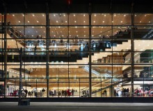 The City Room at Toronto's Four Seasons Centre for the Performing Arts. Lighting design was a crucial consideration for the high-profile opera house fronting busy University Avenue. At night, the glass facade acts as a beacon for the activity within.