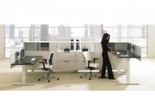 Teknion's new height-adjustable Livello workstation tables in an office context.