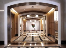 The Dunfield: Main lobby area is designed with rich oak and carpet patterned like marble and stone adding to the intended feeling of luxury.