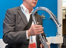 Working with customs, Werner Heinzelmann, Head of the Patents and Intellectual Property Rights division at Hansgrohe SE, removes a pirate copy of a Hansgrohe kitchen mixer from circulation at the ISH trade fair in Frankfurt.