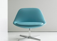Chiara's seat is molded foam over a steel frame and rests on a polished aluminum base with a self-return swivel mechanism