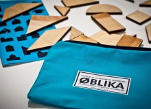 Oblika is a puzzle composed of 22 geometric pieces