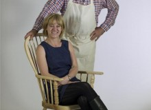 Anthony Glynn with Ali Wilson, seated in a WIndsor chair made by Anthony, Ali and Mark Oram