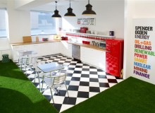 The recruitment firm takes a unique approach to office design, with astro turf used as carpets and locally inspired meeting rooms