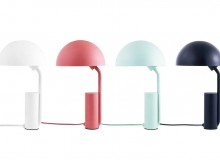 Cap, a functional table lamp with an adjustable shade, was created by the German design duo KaschKasch