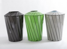 "Central Park Conservancy receptacles are identical in size and shape, different in colour and in the size of top openings: grey with blue around the aperture for cans and bottles, ""conservancy"" green for paper, and tan for waste"
