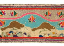 "Hooked rug, ""Beaver and Four Stars,"" c. 1940, 58 cm x 98 cm. T77.0094. Textile Museum of Canada purchase"
