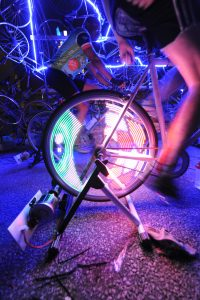 The centrepiece of Energy was teams of triathletes powering MonkeyLectric animated bike wheels that lit up the night with a graphic light show provided by Eurolite. Photography by Bob Gundu.