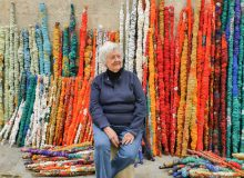 Sheila Hicks in front of elements from The Treaty of Chromatic Zones, 2015. Photo by Cristobal Zanartu