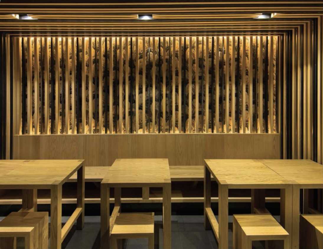 Kinton Ramen in Toronto, by Dialogue 38, features walls clad in highly tactile spruce blocks set at an angle. The broad expanse of unpainted wood evokes the natural, unadulterated purity of the ingredients. Photo by Brian So
