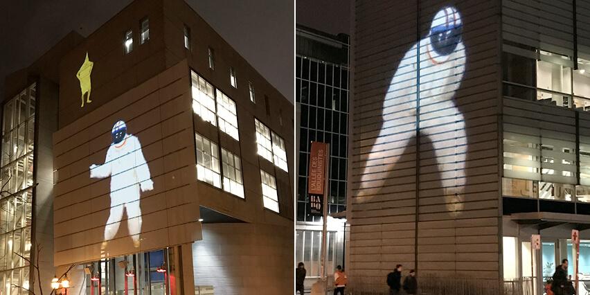 Space Monkey projeted on Centre de design, UQAM and Grande Bibliothèque. Photo: Louise-Édith Vignola