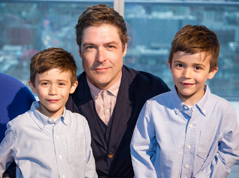 Klaus Nienkamper Jr., president of the Klaus by Nienkamper retail store on King Street East, with his six-year-old twins, Otto and Oliver.
