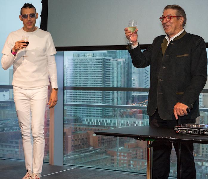 Toronto-born design superstar Karim Rashid, wearing his trademark whites, and Klaus Nienkamper raise a toast after giving brief speeches.