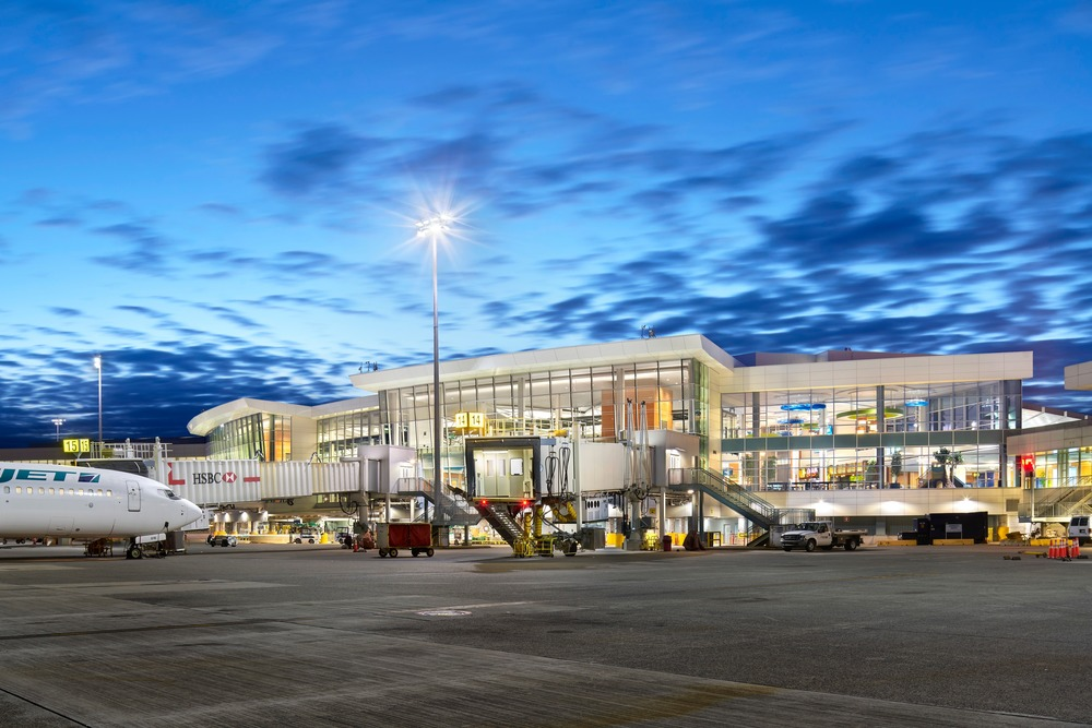Vancouver International Airport A-B Connector - Wall 4000K LED luminaires at 26W provided lighting at doors and 47W for roadway around the building. Extensive exterior glazing allows for significant daylight penetration. Photo credit: Ed White Photography