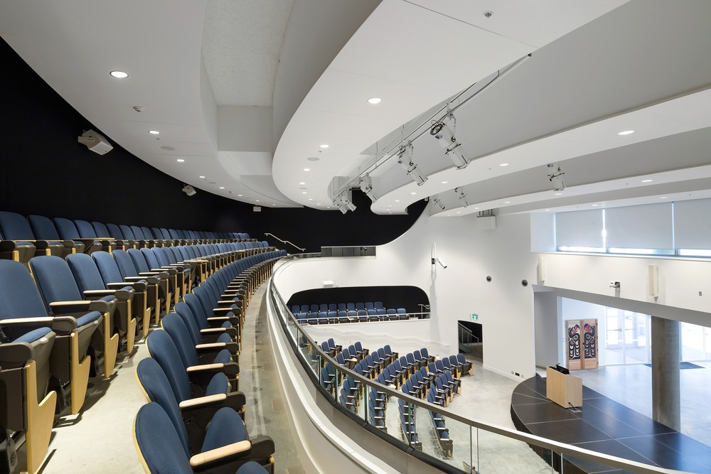 Emily Carr - Recessed dimmable downlights and RGBW-DMX theatrical luminaires provides flexible lighting for the multipurpose theatre through DMX controls. Photo credit: Silent Sama